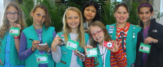 Girl Scouts at a Media Girls program learning to take good digital photos